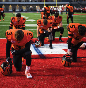 It is tradition for a group of Princeton football players to kneel in prayer prior to each game. The Tigers emerge from the tunnel and head to the end zone, where they reverently bow their heads.